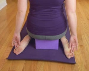 modified Virasana with a block