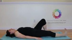 picture of Sarah Stockett doing pilates leg slides