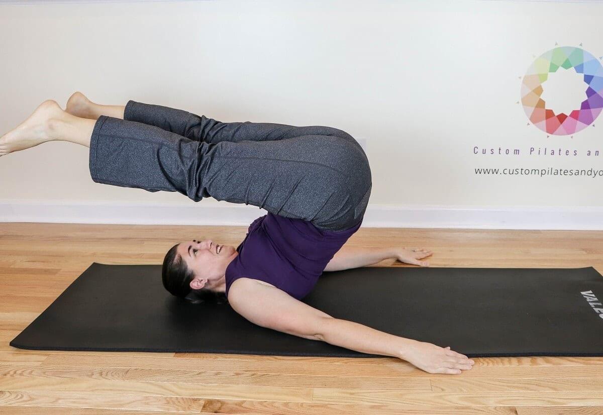Sarah Stockett doing a Pilates roll over exercise