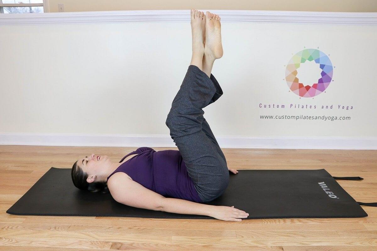 Sarah Stockett doing the Pilates Roll over prep exercise