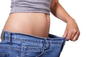 loose jeans on a slim female
