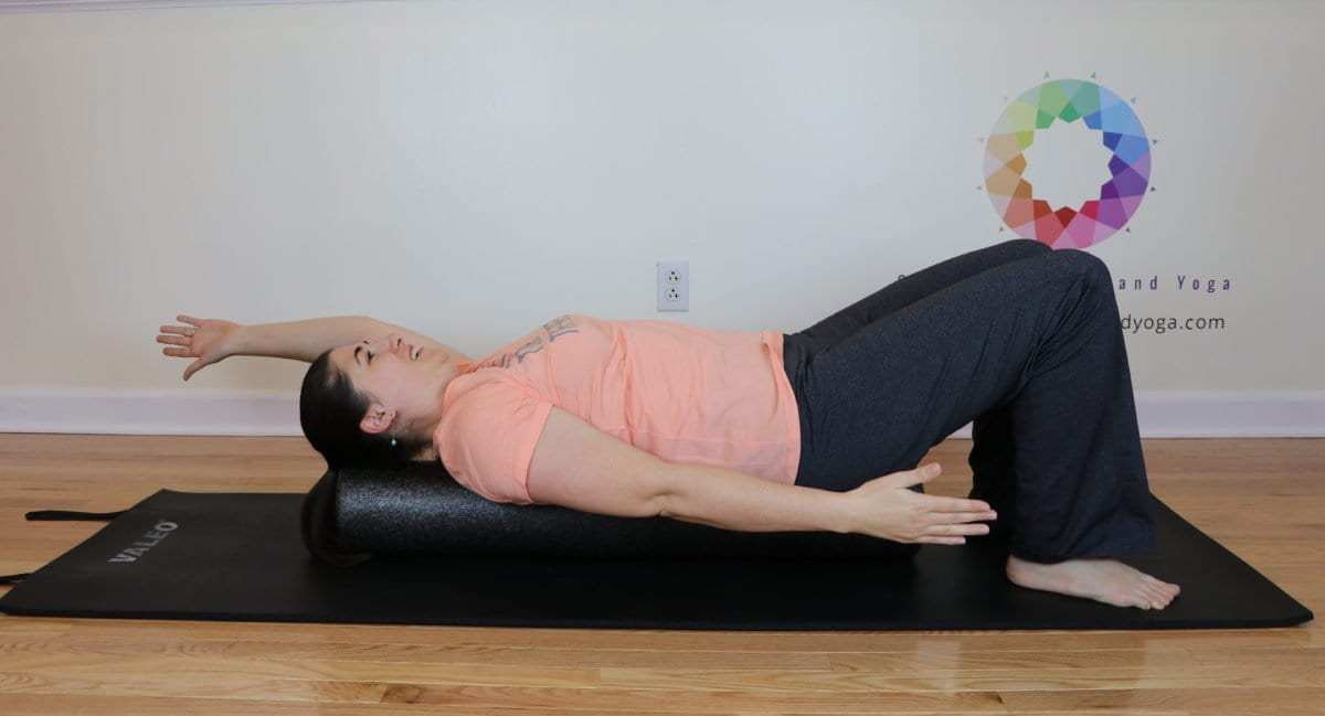 arm scissors on the foam roller