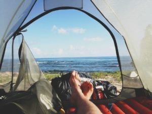 relaxing in a tent with an ocean view