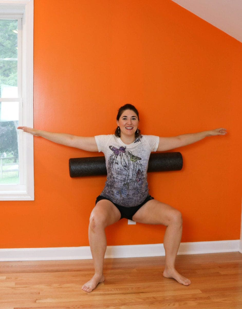 pilates squat with the foam roller