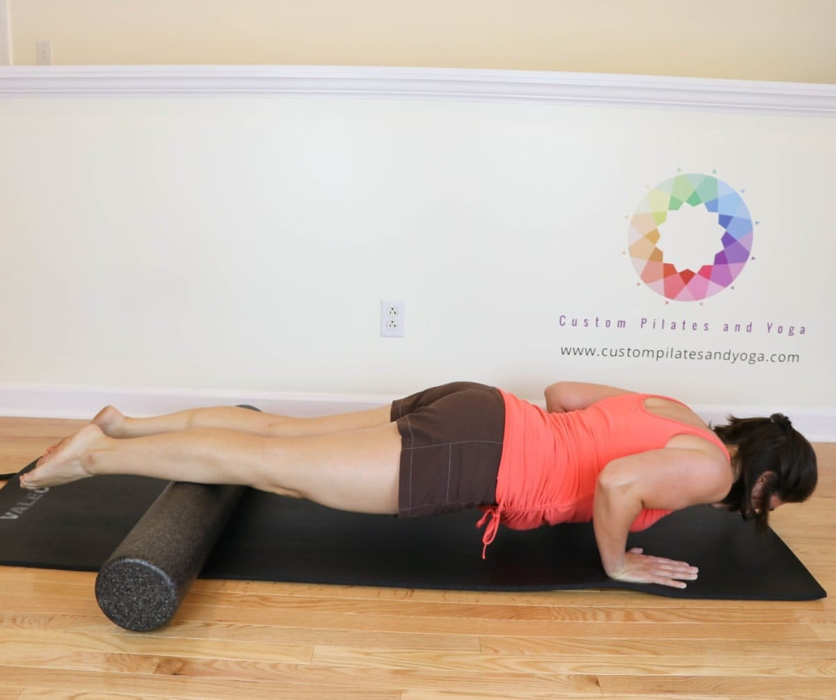 Pilates push-up with a foam roller