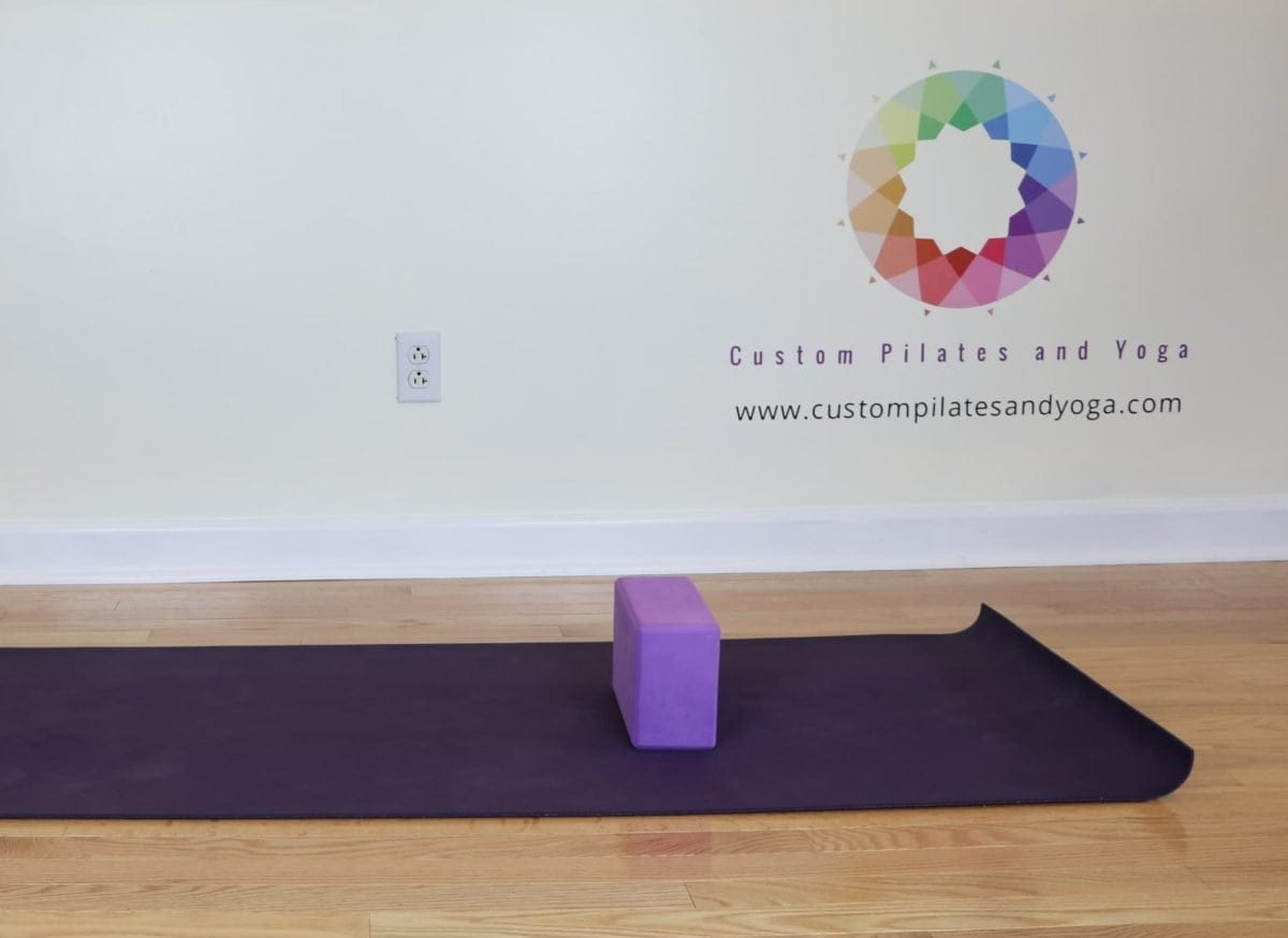 stretch your upper back with yoga blocks
