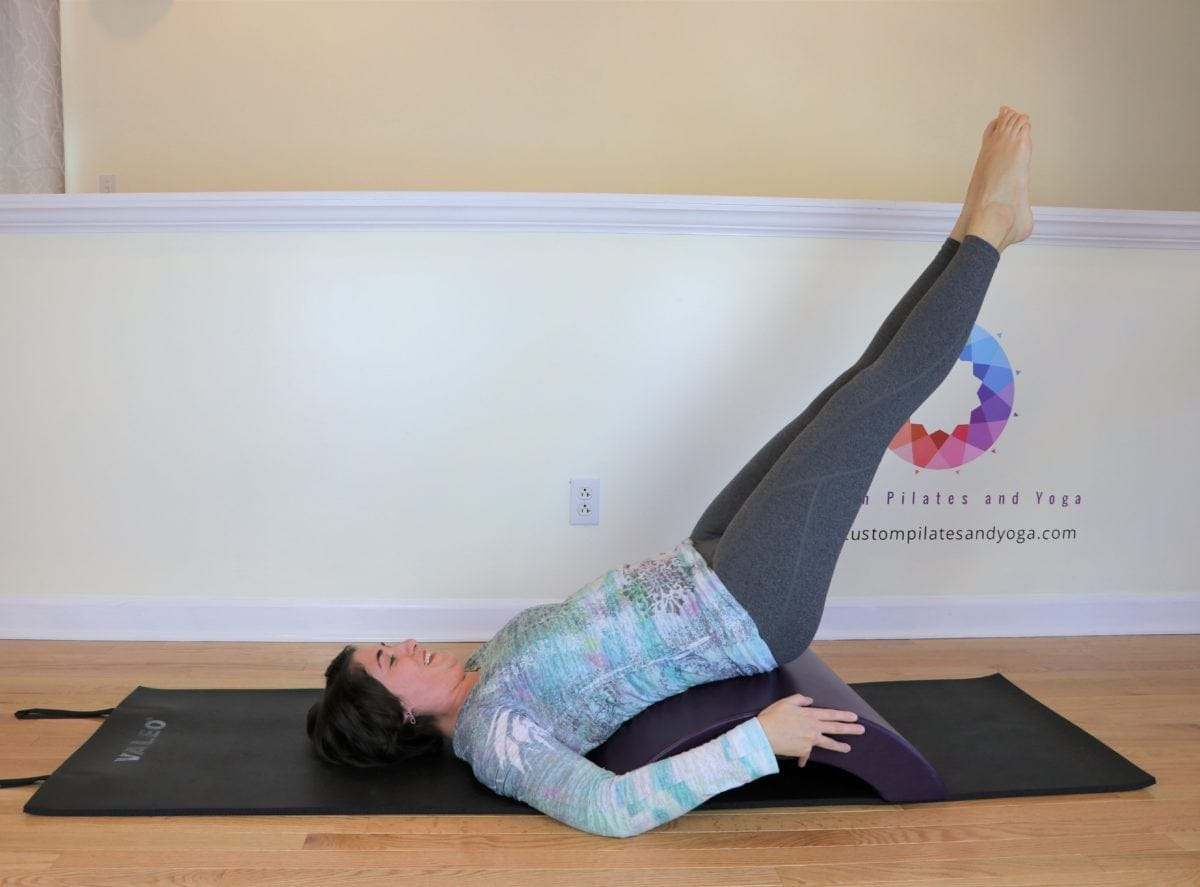 lower and lift on the pilates arc barrel