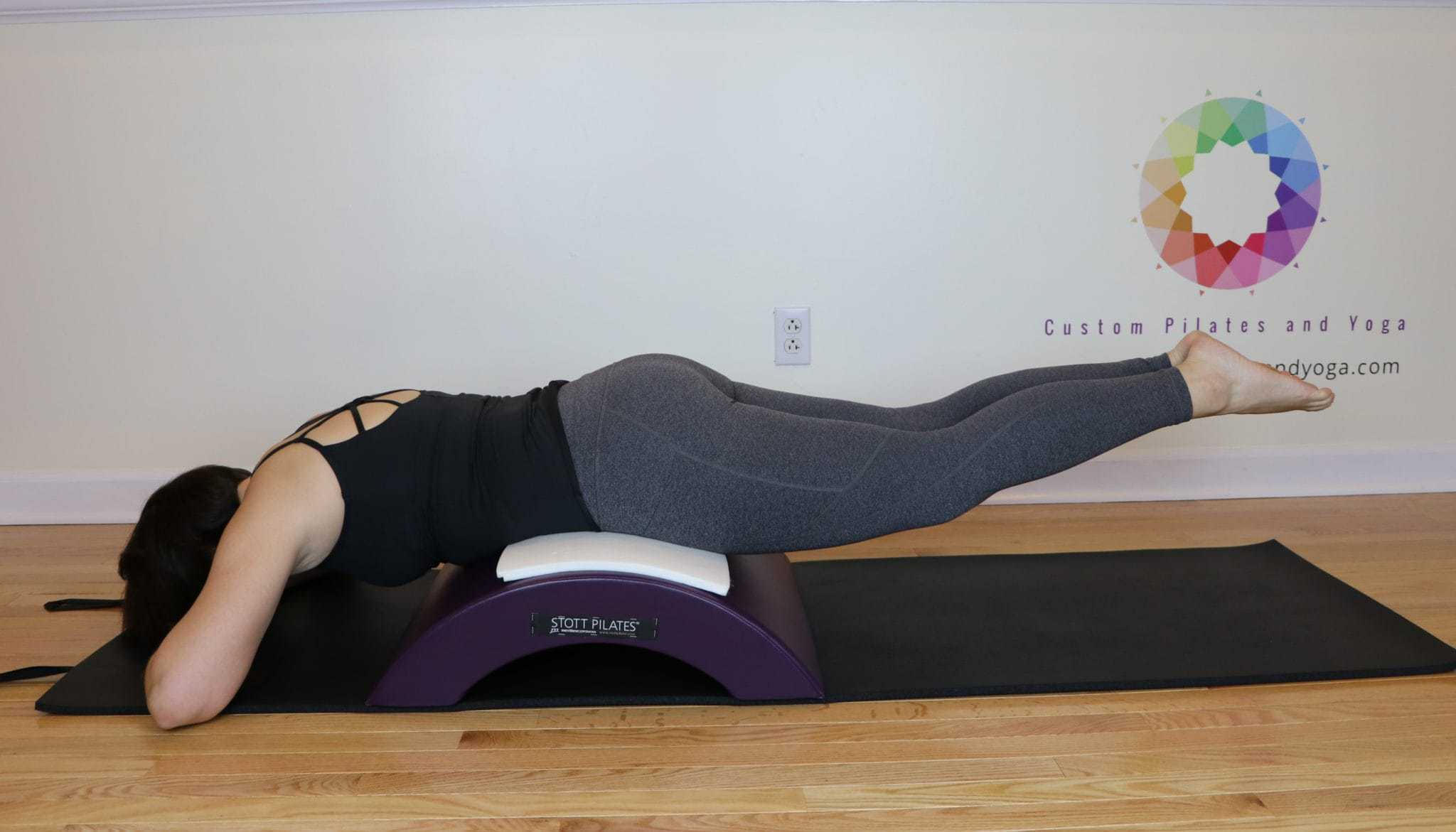 How to Do Lower and Lift Prone on the Pilates Arc Barrel