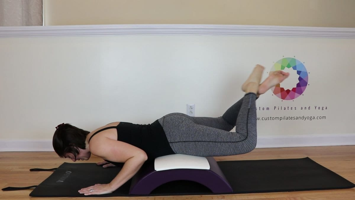 the best way to do pilates grasshopper on the arc barrel