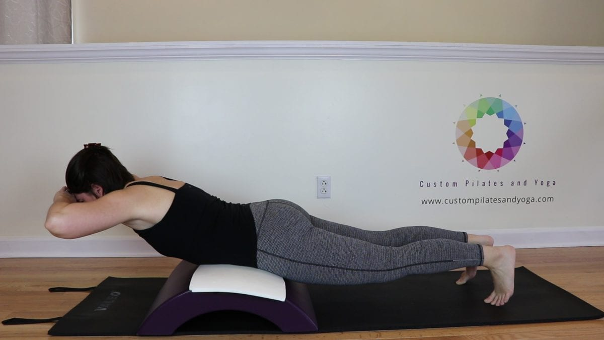 this pilates spinal extension exercise will help you fight back pain