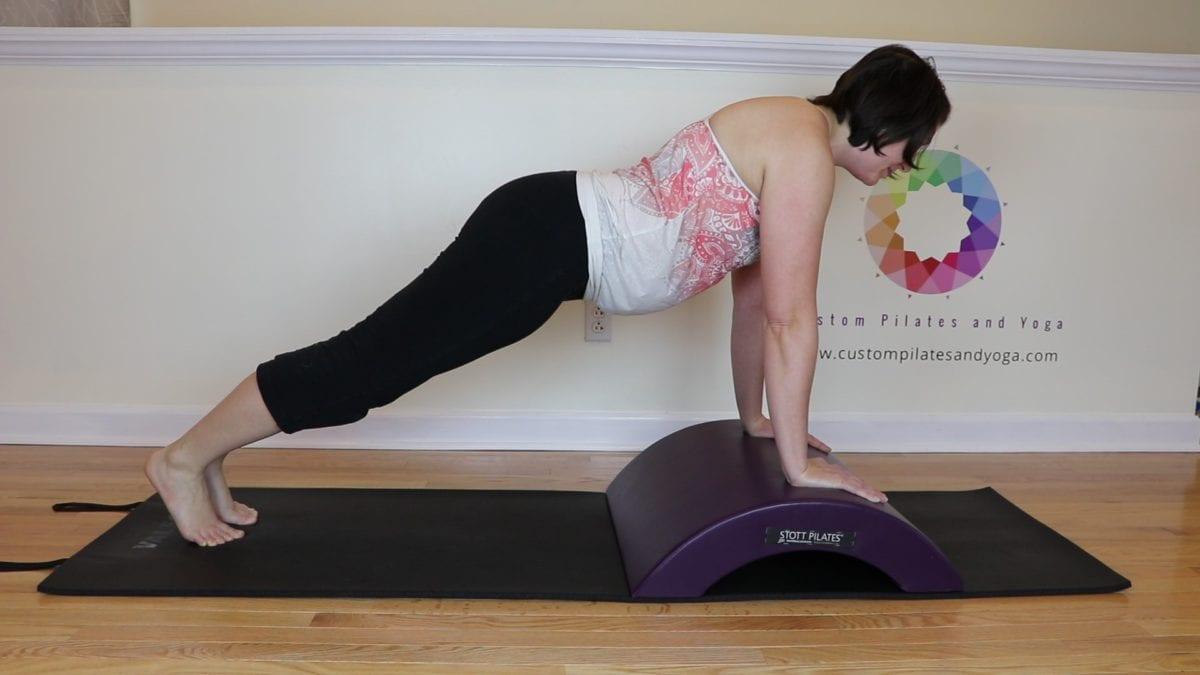 pilates plank on the arc barrel