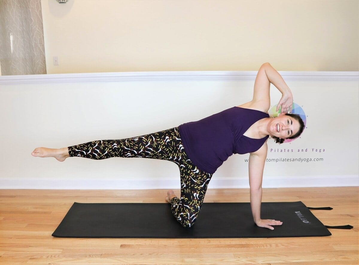 the starting position for practicing the Pilates Side kick kneeling classic mat exercise