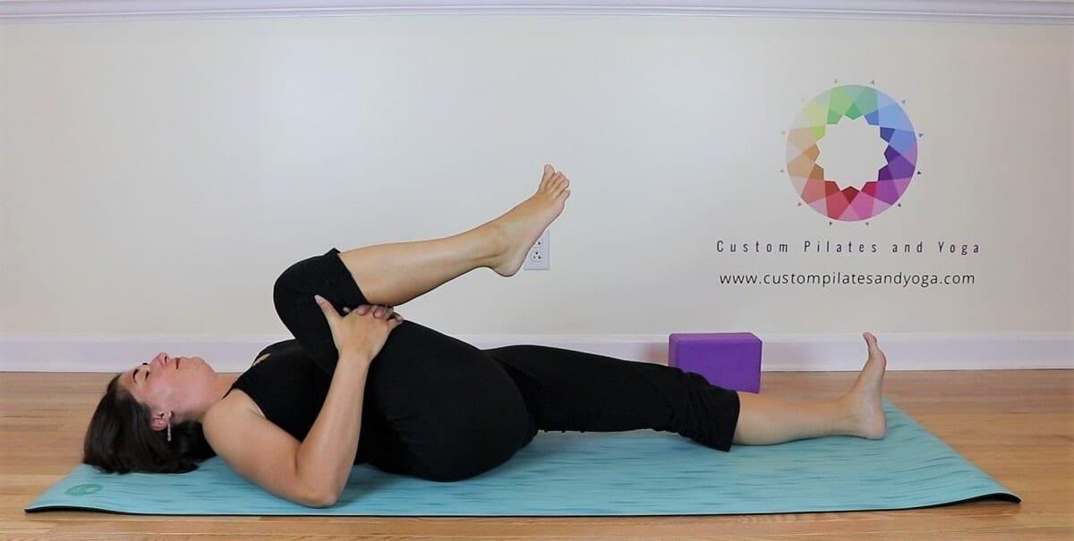 sarah stockett doing knee to chest pose