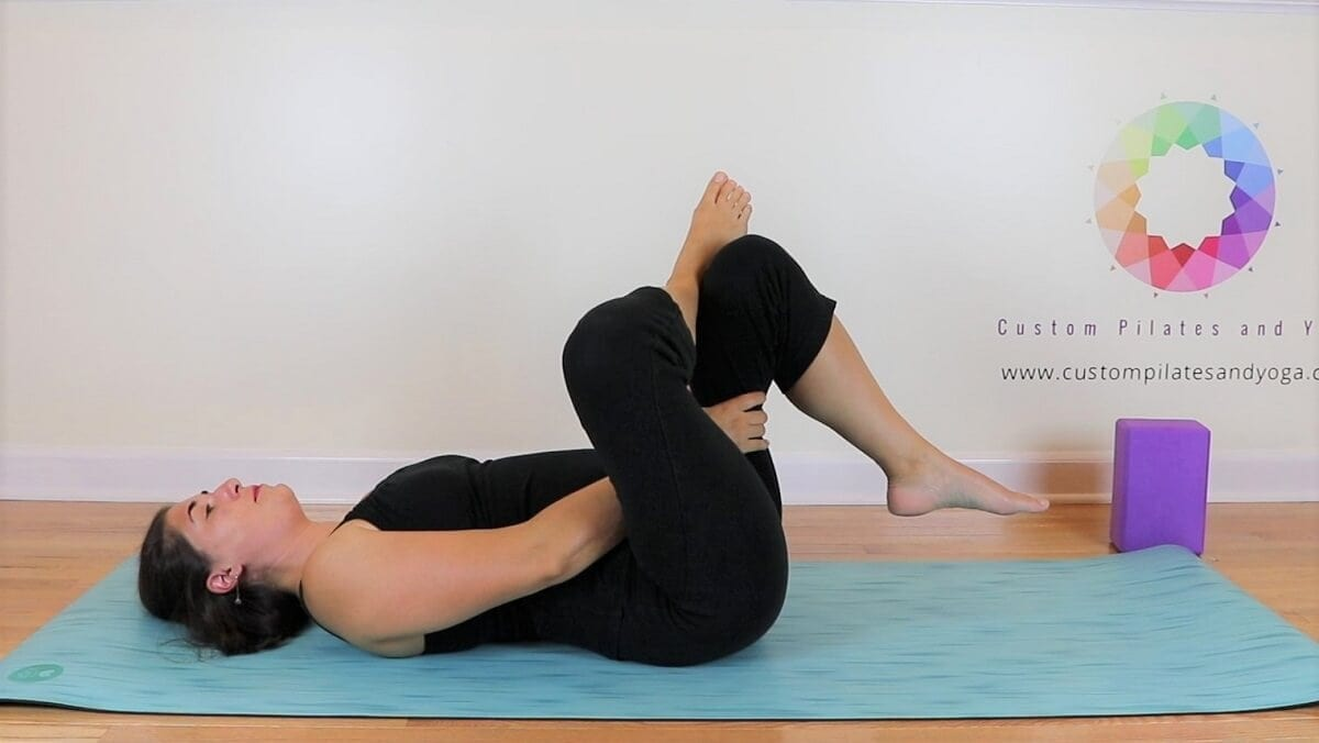 modification of pigeon pose, figure 4 stretch