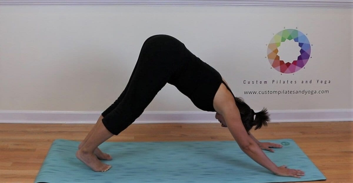 downward facing dog to relieve midback pain