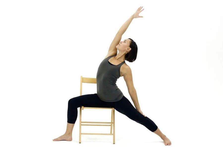 reverse warrior yoga pose in a chair
