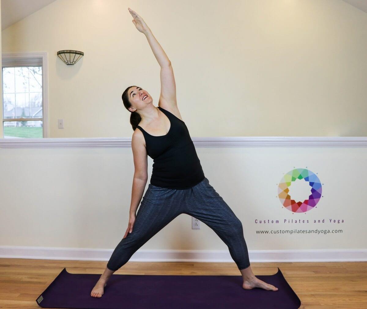 Sarah Stockett practicing reverse warrior pose
