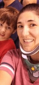 woman with a broken neck at a baseball game