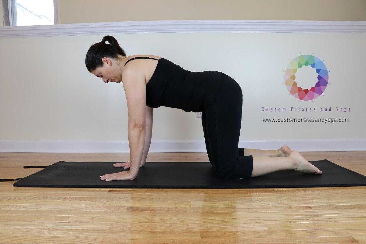 Sarah Stockett practicing table top pose