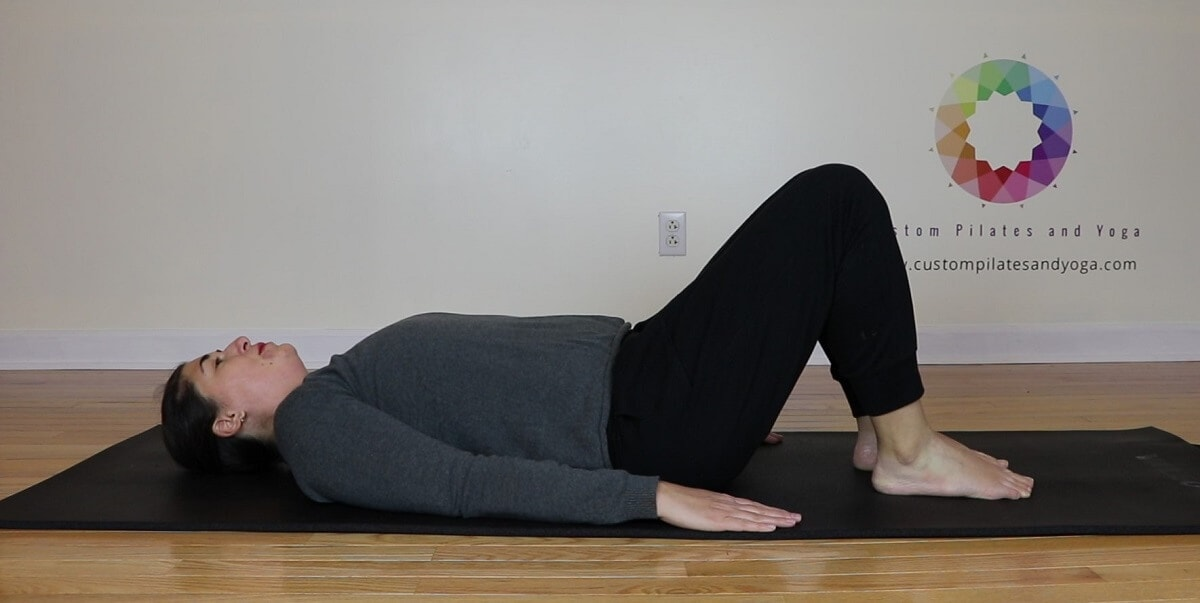 a picture of Sarah Stockett in a neutral position on her back