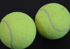 two dead tennis balls could cure your back pain
