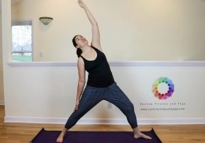 a picture of Sarah Stockett doing Reverse warrior pose to relieve back pain
